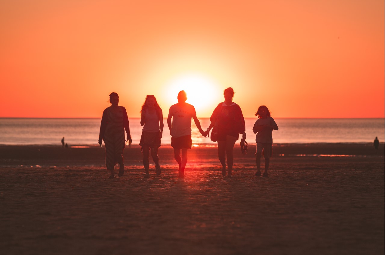 Life Insurance: A family on the beach watching the sunset.