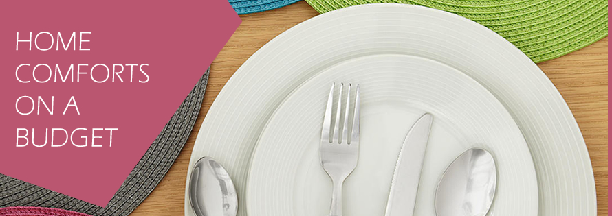 Student Essentials: Home Comforts on a Budget - A dining table setting with colourful woven placemats, dinner plates and cutlery.